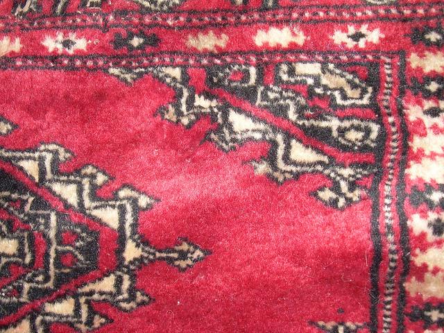A closeup of an Oriental rug's pattern