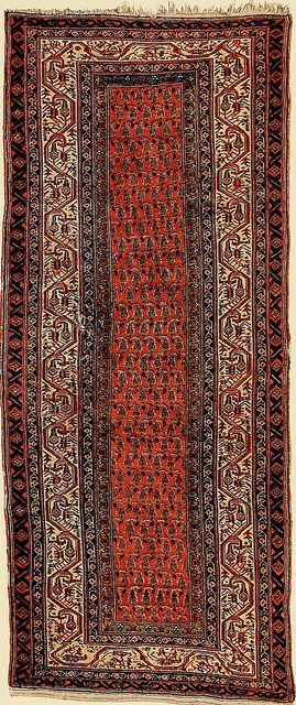 An Oriental pattern carpet runner