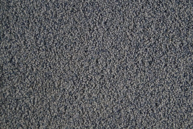 A closeup of gray carpeting
